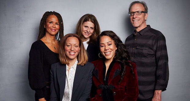 """In this Jan. 26, 2020 file photo, Sil Lai Abrams, back row from left, director Amy Ziering, director Kirby Dick, Drew Dixon, seated left, and Sheri Hines pose for a portrait to promote the film """"On the Record"""" at the Music Lodge during the Sundance Film Festival in Park City, Utah. The film provides an intimate portrayal of the agonizing process of calculating whether to go public with harassment and abuse claims. (Photo by Taylor Jewell/Invision/AP, File)"""