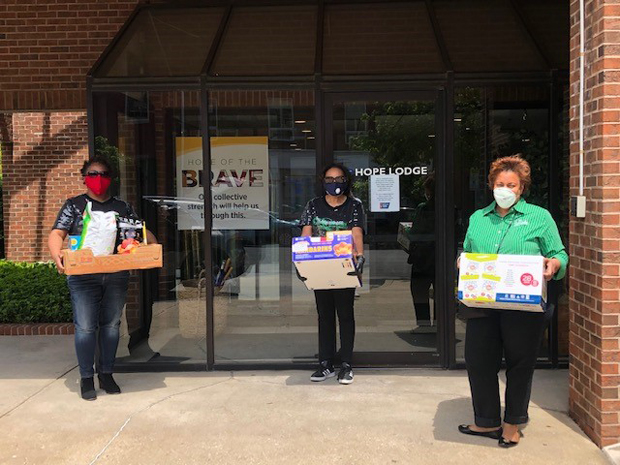 From left, Giovanni Smith, Sharonne Bonardi and Donnice Brown get ready to deliver meals.