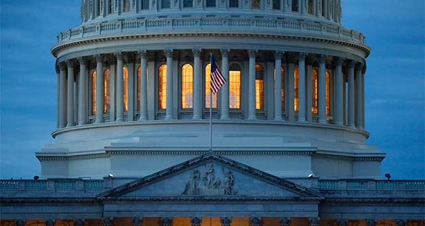 FILE - In this May 3, 2020, file photo, light shines from inside the U.S. Capitol dome at dusk on Capitol Hill in Washington. (AP Photo/Patrick Semansky)