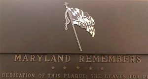 The flag of the state of Maryland covers a part of a plaque commemorating Maryland residents who fought in the Civil War where the U.S. flag and the Confederate flag were once shown, Friday, June 12, 2020 at the Maryland State House in Annapolis, Md. While a four-member panel decided to cover the Confederate flag last year, support is growing to have the plaque removed entirely from the Capitol. (AP Photo/Brian Witte)