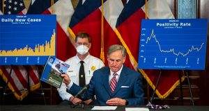 "Gov. Greg Abbott addresses a news conference at the State Capitol in Austin, Texas, about the coronavirus pandemic Monday, June 22, 2020. Abbott said he has no plans to shut down the state again. ""We must find ways to return to our daily routines as well as finding ways to coexist with COVID-19,"" Abbott said. (Ricardo B. Brazziell/Austin American-Statesman via AP)"