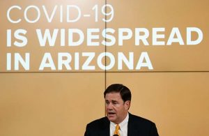 Arizona Republican Gov. Doug Ducey speaks about the latest coronavirus data at a news conference Thursday, June 25, 2020, in Phoenix. (AP Photo/Ross D. Franklin, Pool)