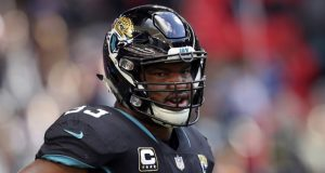 FILE - In this Oct. 28, 2018, file photo,  Oct. 28, 2018. Jacksonville Jaguars defensive end Calais Campbell (93) during the warm-up before an NFL football game against Philadelphia Eagles at Wembley stadium in London. Armed with a new contract after being traded from Jacksonville to Baltimore, five-time Pro Bowl defensive end hopes to be a difference-maker in the Ravens' bid to reach the Super Bowl. (AP Photo/Tim Ireland, File)