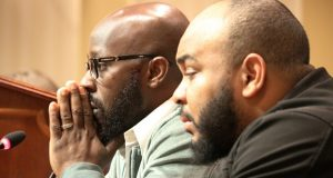 Eric Simmons, left, and Demetrius Smith, who were found innocent after spending years in prison for crimes they did not commit in Maryland, testify before state lawmakers during a hearing Wednesday, Feb. 26, 2020, in Annapolis. Simmons is one of two men for whom a state board Wednesday approved a restitution package. (AP Photo/Brian Witte)