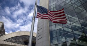 An American flag flies outside the headquarters building of the Securities and Exchange Commission in Washington on Dec. 22, 2018. MUST CREDIT: Bloomberg photo by Zach Gibson.