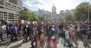 "Thousands of protesters joined the march that ended at City Hall on Monday evening. Despite some violent acts later in the night Mayor Bernard C. ""Jack"" Young praised the restraint of activists and police. (The Daily Record/Adam Bednar)"