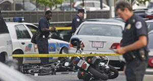 Police work the scene of a shooting near the U.S. Capitol in Washington,  Wednesday, July 15, 2009. Police shot and killed an armed man in what authorities described as a routine rush hour traffic stop that turned deadly.  (AP Photo/Pablo Martinez Monsivais)