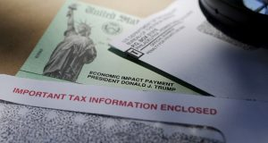 President Donald Trump's name is seen on a stimulus check issued by the IRS to help combat the adverse economic effects of the COVID-19 outbreak. (AP Photo/Eric Gay, File)