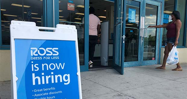 """FILE - In this July 8, 2020, file photo, a """"Now Hiring"""" sign sits outside a Ross Dress for Less store, in North Miami Beach, Fla. Unemployment remains painfully high in the U.S. even as economic activity is slowly picking up. That reality will be on display Thursday, July 16, 2020, when the U.S. government releases data on the number of laid off workers seeking unemployment benefits the week prior and retail sales in June. (AP Photo/Wilfredo Lee, File)"""