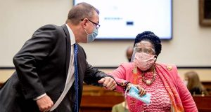 Federal Emergency Management Agency Administrator Peter Gaynor, left, greets Rep. Sheila Jackson Lee, D-Texas, right, as he arrives to testify before a House Committee on Homeland Security meeting on Capitol Hill in Washington, Wednesday, July 22, 2020, on the national response to the coronavirus pandemic. (AP Photo/Andrew Harnik, Pool)