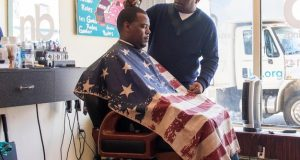 Troy Staton heads a network of barbers and beauticians helping clients cope with trauma in Baltimore in May 2020. He owns New Beginnings barbershop in Baltimore's Hollins Market neighborhood. (Photo courtesy Troy Staton)