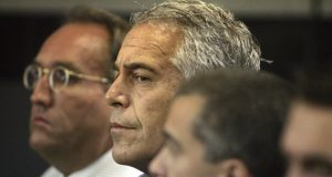 FILE- In this July 30, 2008, file photo, Jeffrey Epstein appears in court in West Palm Beach, Fla.  Newly unsealed court documents provide a fresh glimpse into a fierce civil court fight between Epstein's ex-girlfriend, Ghislaine Maxwell, and one of the women who accused the couple of sexual abuse. The documents released Thursday, July 30, 2020, were from a now-settled defamation lawsuit filed by one of Epstein's alleged victims, Virginia Roberts Giuffre. (Uma Sanghvi/Palm Beach Post via AP, File)