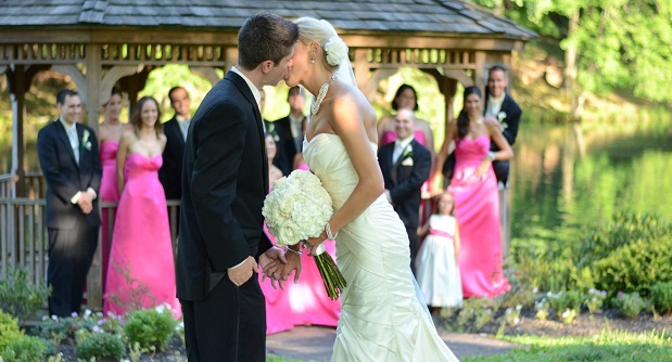 A wedding kiss in more normal times at Padonia Park Club in Cockeysville. Wedding planners, venues, caterers, photographers, florists and others dependent on the wedding industry have had a rough go during the pandemic. (Padonia Park Club)