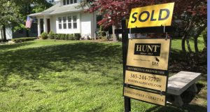 FILE - This May 22, 2020 file photo shows a sold sign in front of a house in Brighton, N.Y. Long-term U.S. mortgage rates fell this week with the benchmark 30-year home loan hitting its lowest level ever. Mortgage buyer Freddie Mac reported Thursday, July 2 that the average rate on the key 30-year fixed-rate mortgage fell to 3.07%, down from last week's 3.13%. (AP Photo/Ted Shaffrey, File)