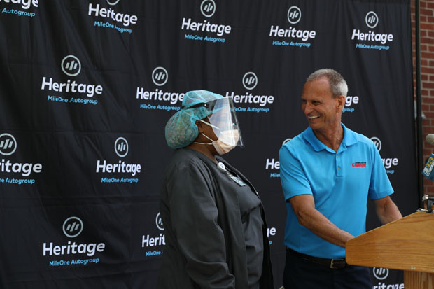 Martin Schwartz, president of Vehicles for Change, surprises Northwest Hospital nursing assistant Listra Williams with a car to kick off a day of awarding cars to families in need. (Photo courtesy of Vehicles For Change)