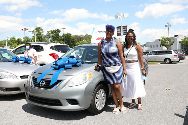 Jada Little of Edgewood was joined by a friend as she was presented with a vehicle. Little will be starting a new job on July 1 and will no longer need to rely on family for transportation assistance. (Photo courtesy of Vehicles For Change)