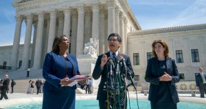 FILE - In this April 23, 2019, file photo Dale Ho, center, an attorney for the American Civil Liberties Union, is flanked by New York State Attorney General Letitia James, left, and New York City Census Director Julie Menin, as they speak to reporters after the Supreme Court heard arguments over the Trump administration's plan to ask about citizenship on the 2020 census, in Washington.  The ACLU prevailed in a U.S. Supreme Court case blocking the administration from placing a citizenship question on the 2020 census. (AP Photo/J. Scott Applewhite, File)