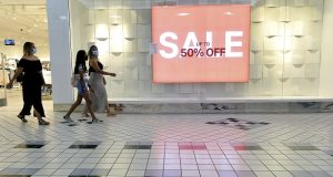 Shoppers walk through the Valley Mall in Halfway, Md., Tuesday, August, 11, 2020, during Maryland Tax-Free Week. From Aug. 9-15, any single qualifying article of clothing or footwear priced $100 or less, no matter how many items purchased at the same time, will be exempt from the state's 6% sales tax.  (Colleen McGrath/The Herald-Mail via AP)