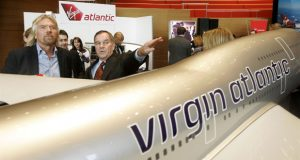 Sir Richard Branson, left, and Chicago Mayor Richard Daley stand next to a model of a Virgin Atlantic Airways 747 during a news conference Monday, Dec. 4, 2006, in Chicago. Branson was in Chicago to announce his Virgin Atlantic Airways will begin daily service between London Heathrow and Chicago's O'Hare International Airport next year.  (AP Photo/Charles Rex Arbogast)