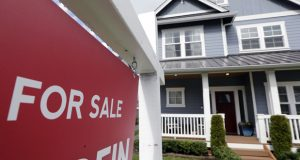 "FILE - In this April 1, 2020 photo, a ""For Sale"" sign stands in front of a home that is in the process of being sold in Monroe, Wash., outside of Seattle. U.S. home sales rose a record-breaking 24.7% in July, extending last month's rebound after the coronavirus pandemic all but froze the housing market this spring, the National Association of Realtors said Friday, Aug. 21, 2020. (AP Photo/Elaine Thompson, File)"