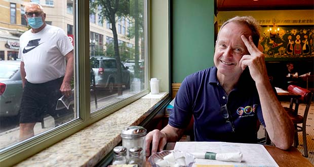 Chicago Alderman Tom Tunney poses inside his main Ann Sather restaurant, Tuesday, Sept. 1, 2020, in Chicago. Tunney estimates he's put $250,000 of his own money into running his three Ann Sather restaurants. Social distancing requirements have curtailed revenue and the PPP loan Tunney got was quickly spent paying staff at the restaurants that are neighborhood breakfast and brunch stalwarts. (AP Photo/Charles Rex Arbogast)