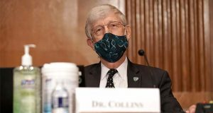Dr. Francis Collins, Director of the National Institutes of Health, attends a Senate Health, Education, Labor and Pensions Committee hearing to discuss vaccines and protecting public health during the coronavirus pandemic on Capitol Hill, Wednesday, Sept. 9, 2020, in Washington. (Greg Nash/Pool via AP)