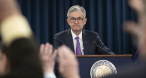 FILE - In this Jan. 30, 2019, file photo, Federal Reserve Chairman Jerome Powell waits for a question from a reporter at a news conference in Washington. Federal Reserve policymakers will meet for two days beginning Tuesday, Sept. 15, 2020, for the first time since they significantly revised the Fed's operating framework in ways that will likely keep short-term interest rates near zero for years to come. (AP Photo/Alex Brandon, File)
