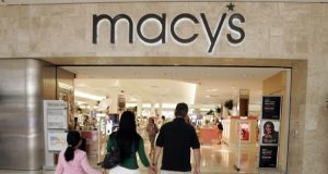 **FILE** In this Aug. 12, 2008 file photo, a family walks into a Macy's store in San Jose, Calif., Tuesday, Aug. 12, 2008. Department store operator Macy's Inc. reported Wednesday, Nov. 12, 2008, that its third-quarter results swung to a loss from a profit a year ago as results were hampered by a drop in consumer spending amid a deteriorating economy. (AP Photo/Paul Sakuma, File)