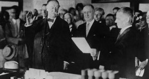 Former President William H Taft, at left, takes the oath of office as chief justice of the U.S. Supreme Court on July 11, 1921. Taft used his political acumen to secure a robust expansion of judicial power in the Judiciary Act of 1925. (AP File Photo)