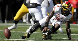 FILE - In this Oct. 20, 2018, file photo, Maryland quarterback Tyrrell Pigrome (3) fumbles the ball during the second half of an NCAA college football game against Iowa, in Iowa City, Iowa. Iowa defensive end Anthony Nelson recovered the ball in the end zone for a touchdown. Interim coach Matt Canada came up with all sorts of reasons why Maryland's offense went nowhere last weekend in a shutout loss to Iowa. (AP Photo/Charlie Neibergall, File)