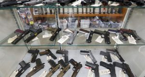 Semi-automatic handguns on display at a gun shop. Johns Hopkins University will be part of national research project on the effectiveness of extreme risk protection orders in Maryland and elsewhere that allow police to take away a person's guns. (AP Photo/Keith Srakocic)