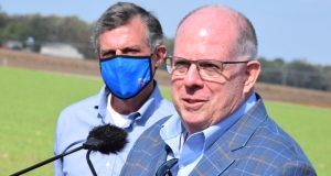 Gov. Larry Hogan and Delaware Gov. John Carney at the Cherry Lane Farm in Hurlock on Monday, Oct. 19, 2020. (The Daily Record/Bryan P. Sears)