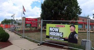 "In this Aug. 18, 2020 photo, a ""Now Hiring"" sign hangs in front of a Sheetz convenience store and gas station under construction in Wexford, Pa. On Thursday, Nov. 19, 2020, the number of Americans seeking unemployment aid rose last week to 742,000,  the first increase in five weeks and a sign that the resurgent viral outbreak is likely slowing the economy and forcing more companies to cut jobs. (AP Photo/Ted Shaffrey)"