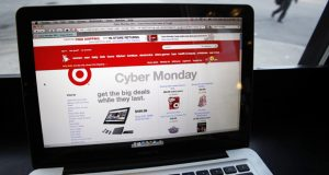 The Target web site is shown on a computer screen at a coffee shop in Providence, R.I. Monday, Nov. 28, 2011. Online sales on Cyber Monday, which was started in 2005 by a retail trade group to encourage Americans to shop online on the Monday after Thanksgiving, were up mid-afternoon by 15 percent from a year ago, according to data from IBM Benchmark. (AP Photo/Michael Dwyer)