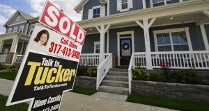 """FILE - A """"sold"""" sign is posted on a home in Westfield, Ind., Friday, Sept. 25, 2020.  On Thursday, Nov. 5, U.S. long-term mortgage rates were flat to lower this week, as the key 30-year rate fell to a new all-time low for the 12th time this year.   (AP Photo/Michael Conroy)"""