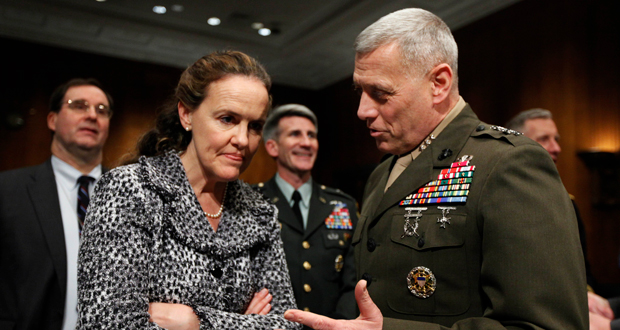 In this Feb. 22, 2010, file photo then-Defense Undersecretary for Policy Michele Flournoy, left, talks with Marines Lt. Gen. John Paxton, director for operations, the Joint Staff, talk on Capitol Hill in Washington. Flournoy, a politically moderate Pentagon veteran, is regarded by U.S. officials and political insiders as a top choice for President-elect Joe Bide to choose to head the Pentagon. (AP Photo/Manuel Balce Ceneta, File)