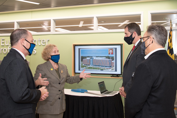 From left , Board of Trustees Chair Gene Lietner, CCBC President Dr. Sandra Kurtinitis, Baltimore County Executive John Olszewski Jr. and CCBC Foundation Chair Michael A. Carper chat share a conversation at the dedication of the Carol Diane Eustis Center for Health Professions at CCBC Essex.