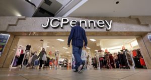 FILE - In this Nov. 24, 2017, file photo, a shopper heads into a J.C. Penney store in Seattle. Mall owners Simon Property Group and Brookfield Property Partners are close to a deal to buy department store chain J.C. Penney out of bankruptcy and keep the chain running, an attorney for Penney's announced Wednesday, Sept. 9, 2020. (AP Photo/Elaine Thompson, File)