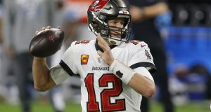 Tampa Bay Buccaneers quarterback Tom Brady, shown here during the first half of an NFL football game against the Detroit Lions in December, once again is seeking to acquire more federal trademark registrations. (AP Photo/Al Goldis)