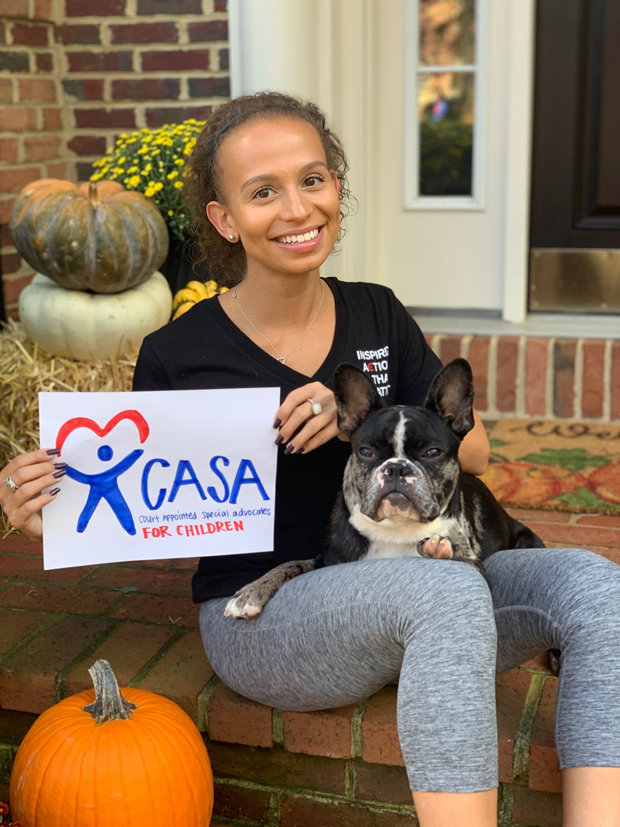 Tank the Dog approves of Demetra Zuras' donation to Casa for Children. (Photo courtesy of Crosby Marketing Communications)