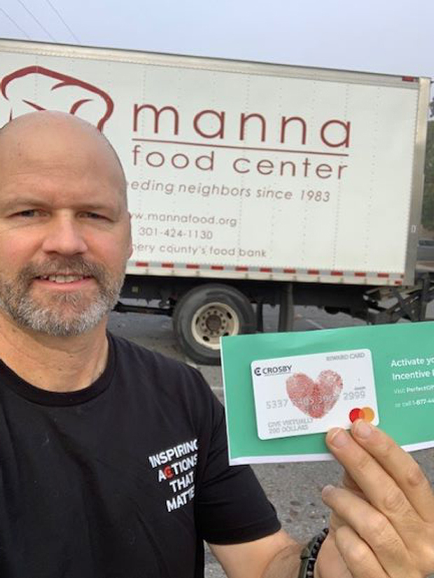 Crosby team member Chris Gearon's $200 donation went to support the Manna Food Center. (Photo courtesy of Crosby Marketing Communications)