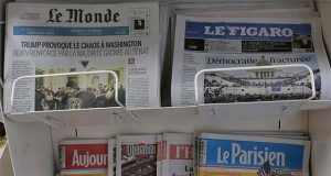 Copies of the French newspapers Le Monde and Le Figaro headline on the Capitol storming, Thursday Jan.7, 2021 in Boulogne-Billancourt, outside Paris. Congress confirmed Democrat Joe Biden as the presidential election winner early Thursday after a violent mob loyal to President Donald Trump stormed the U.S. Capitol in a stunning attempt to overturn America's presidential election. (AP Photo/Christophe Ena)