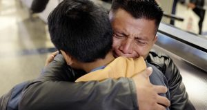 David Xol-Cholom, of Guatemala, hugs his son Byron at Los Angeles International Airport as they reunite on Jan. 22, 2020, after being separated during the Trump administration's wide-scale separation of immigrant families. A court-appointed committee has yet to find the parents of 628 children separated at the border early in the Trump administration. (AP Photo/Ringo H.W. Chiu, File)