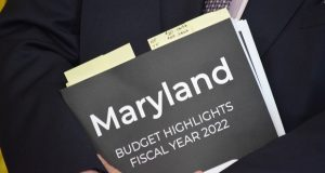 A copy of the highlights of governor's proposed 2022 fiscal year budget held by Budget Secretary David Brinkley at Tuesday's briefing. (The Daily Record/Bryan P. Sears)