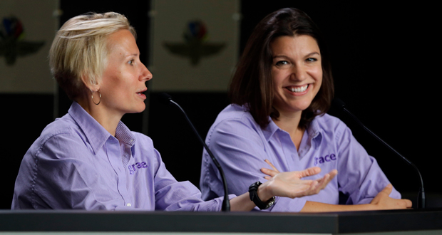 In this May 15, 2015, photo, Beth Paretta, left, and driver Katherine Legge announce the formation of Grace Autosport, the first all female IndyCar Series racing team during a press conference at Indianapolis Motor Speedway in Indianapolis. The effort stalled when Paretta's team couldn't find a suitable car. Paretta and Simona de Silvestro will be teaming up to put another woman on the Indianapolis 500 starting grid this May. On Tuesday, Jan. 19, 2021, Paretta Autosport and IndyCar officials announced they would work together to put a predominantly women-run team in the series' biggest race as part of an outreach to create more diversity in motorsports. (AP Photo/Michael Conroy, File)
