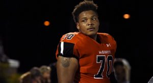 FILE - In this Sept. 16, 2016, file photo, McDonogh high school football lineman Jordan McNair watches from the sideline during a game in McDonogh, Maryland. McNair collapsed on the field and subsequently died of heatstroke.  (Barbara Haddock Taylor/The Baltimore Sun via AP, File)/The Baltimore Sun via AP)