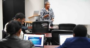 Dr. Lorece Edwards from Morgan State University's School of Community Health & Policy engages with students in topics related to related to public health. (Photo courtesy of Morgan State University)