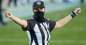 Down Judge Sarah Thomas gestures during an NFL football game between the Denver Broncos and the Carolina Panthers in Charlotte, N.C., in this Sunday, Dec. 13, 2020, file photo. Sarah Thomas will cap her sixth NFL season by becoming the first female to officiate the Super Bowl in NFL history. Thomas, a down judge, is part of the officiating crew announced Tuesday, Jan. 19, 2021, by the NFL. (AP Photo/Brian Westerholt, File)