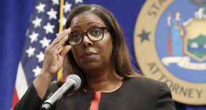 FILE — In this Aug. 6, 2020, file photo, New York State Attorney General Letitia James adjusts her glasses as she announces that the state is suing the National Rifle Association during a press conference, in New York. A New York judge on Thursday, Jan. 21, 2021, denied the National Rifle Association's bid to throw out a state lawsuit that seeks to put the powerful gun advocacy group out of business. (AP Photo/Kathy Willens, File)