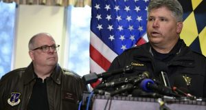 St. Mary's County Sheriff Tim Cameron, right, speaks as Maryland Gov. Larry Hogan, left, listens during a March 20, 2018 news conference about the shooting at Great Mills High School. Cameron says proposed legislation would take away the essential community aspect of the school resource officer program, making the officers nothing more than bodyguards for hire. A school resource officer's speedy response to the Great Mills shooting is credited with avoiding more bloodshed. (AP Photo/Susan Walsh)